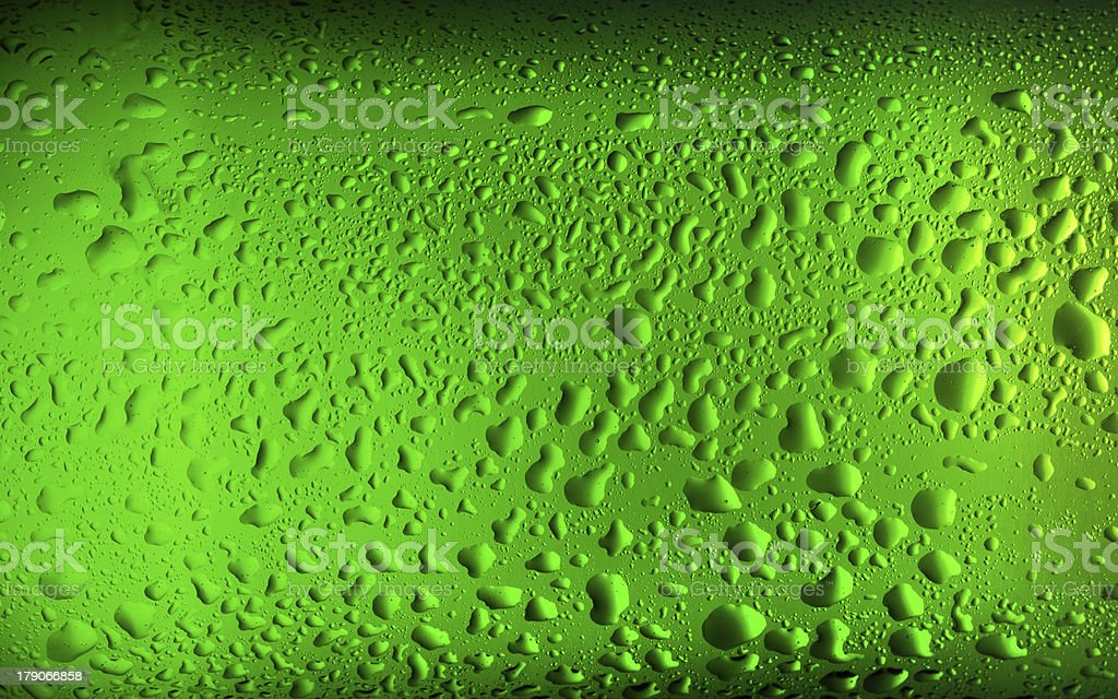 Texture water drops on the bottle of beer. royalty-free stock photo