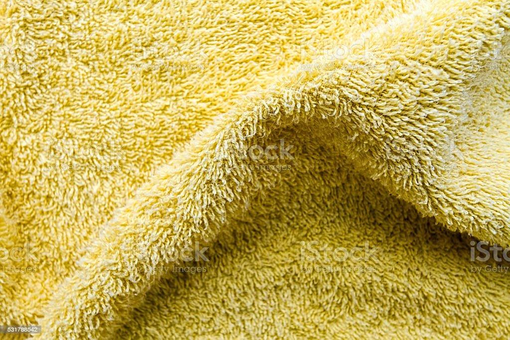Texture yellow fold towel stock photo