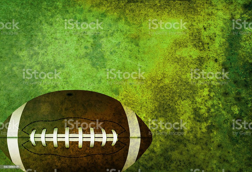Textured American Football Field Background with Ball stock photo
