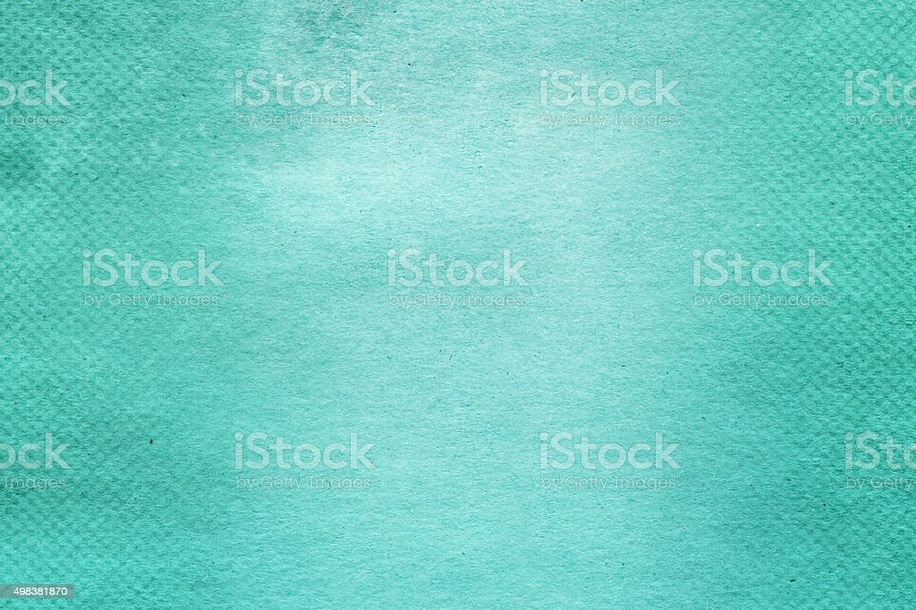 Textured aqua color paper with halftone gradient stock photo