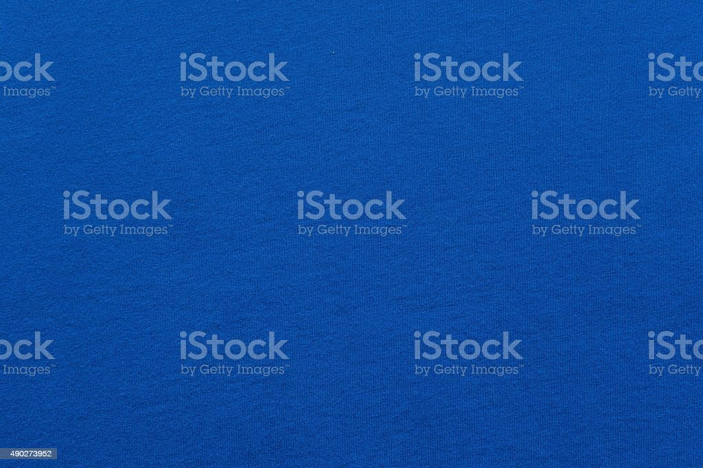 textured background fabric of blue color stock photo