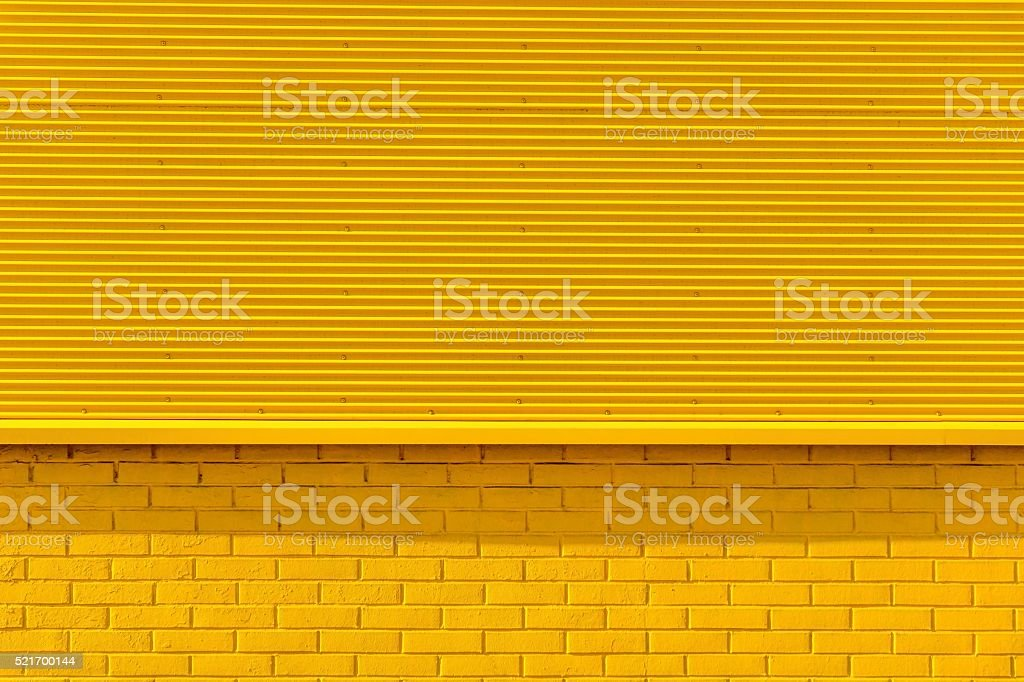 textured background from fluted iron and a brick stock photo