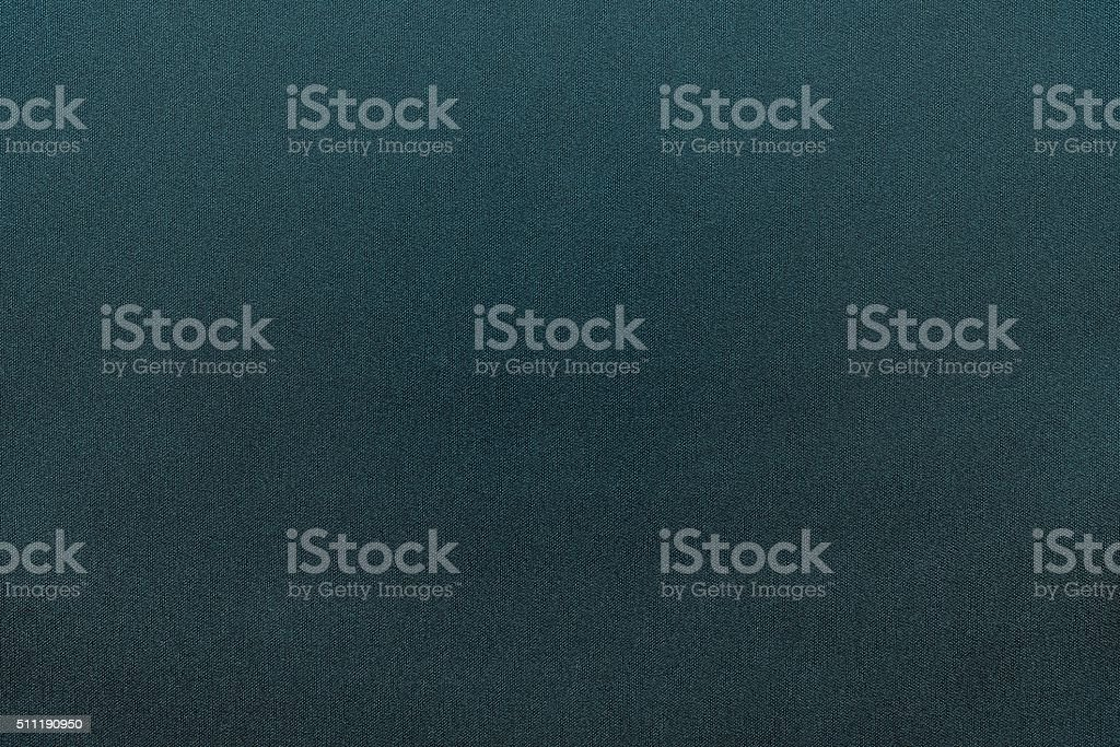 textured background from textile fabric of dark turquoise color stock photo