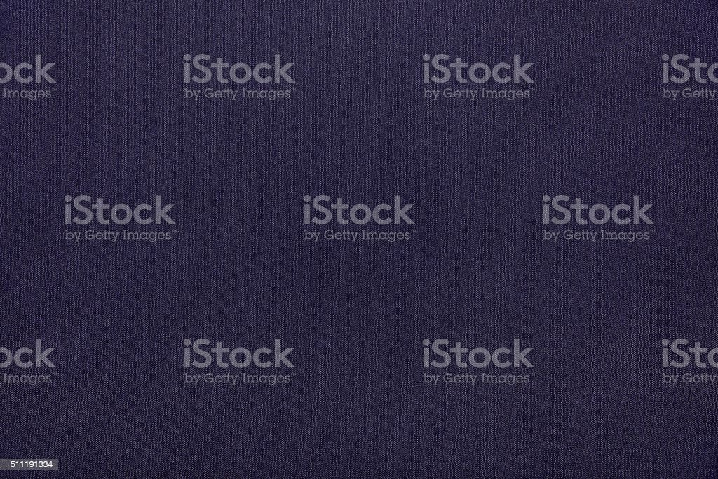 textured background from textile fabric of dark violet color stock photo