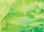 Textured background hand painted with hues of green