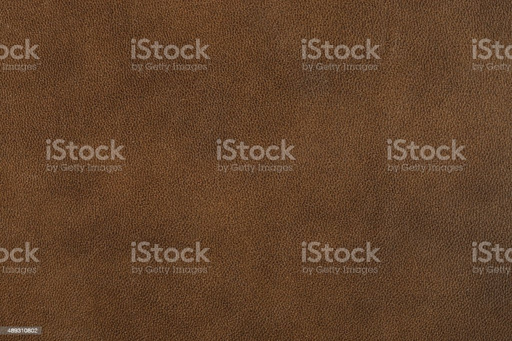 Textured background of genuine dull brown leather. stock photo