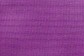 textured background rough fabric of lilac color