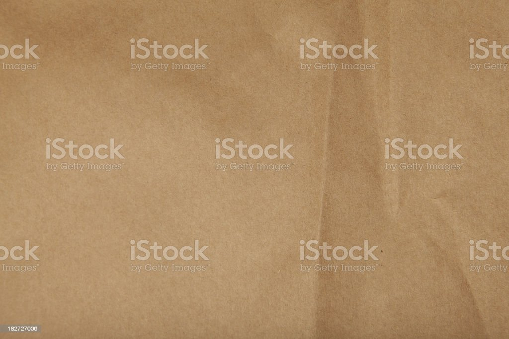Textured brown paper background stock photo
