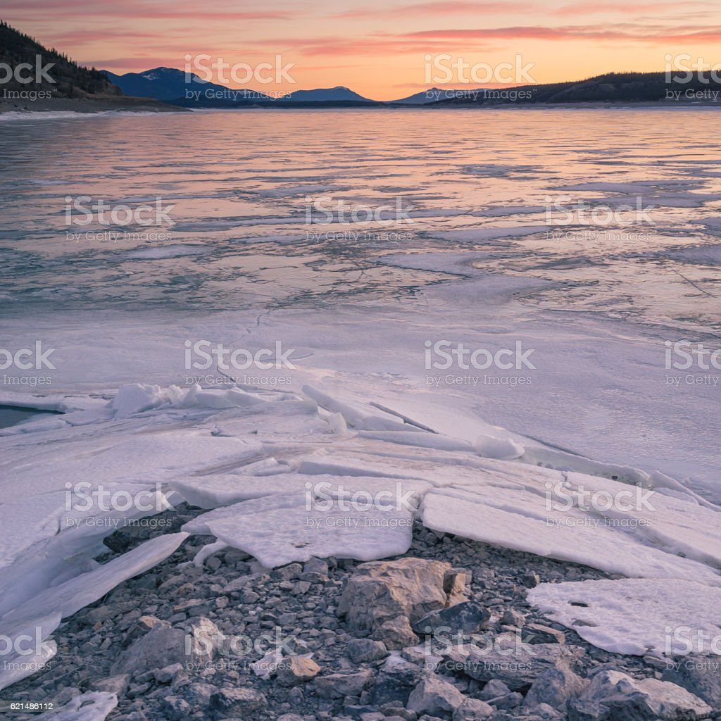Textured Foreground of Icy Abraham Lake stock photo