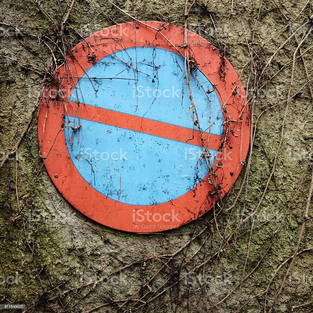 Textured no-parking area sign stock photo