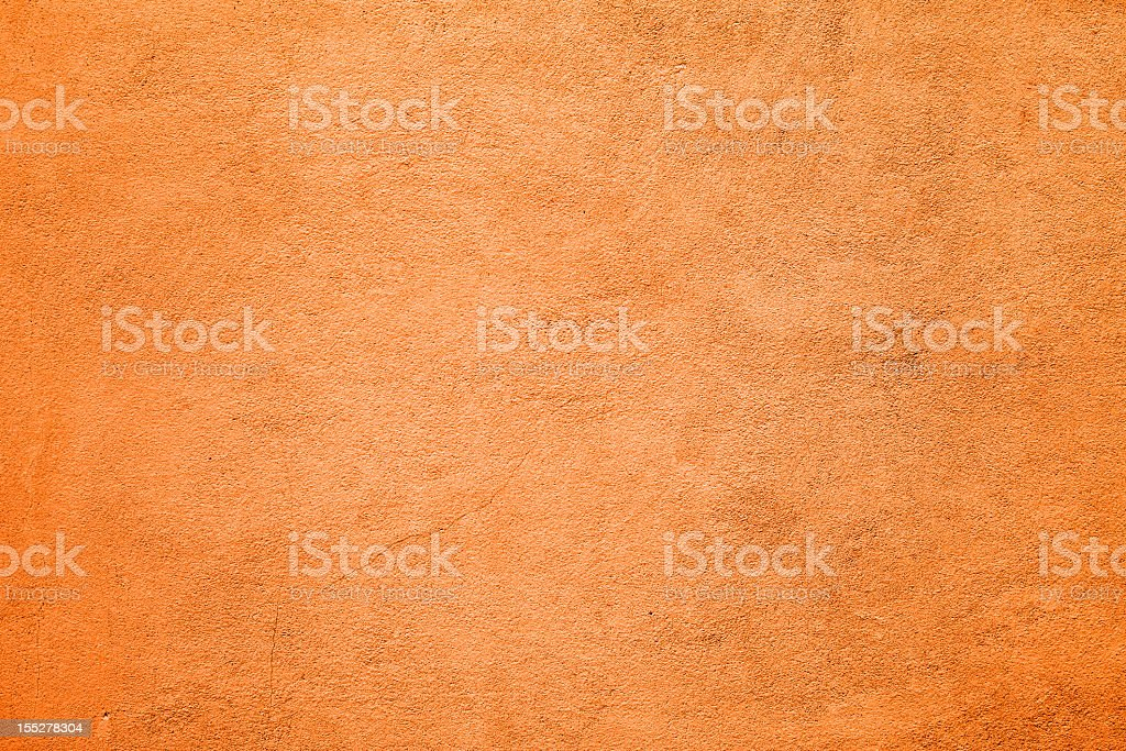 A textured orange concrete wall background stock photo