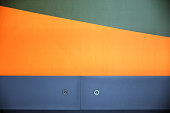 Textured paintable wallpaper and two blue panels. Polygonal multicolor composition
