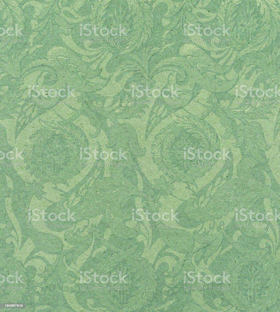 textured paper with antique ornament stock photo