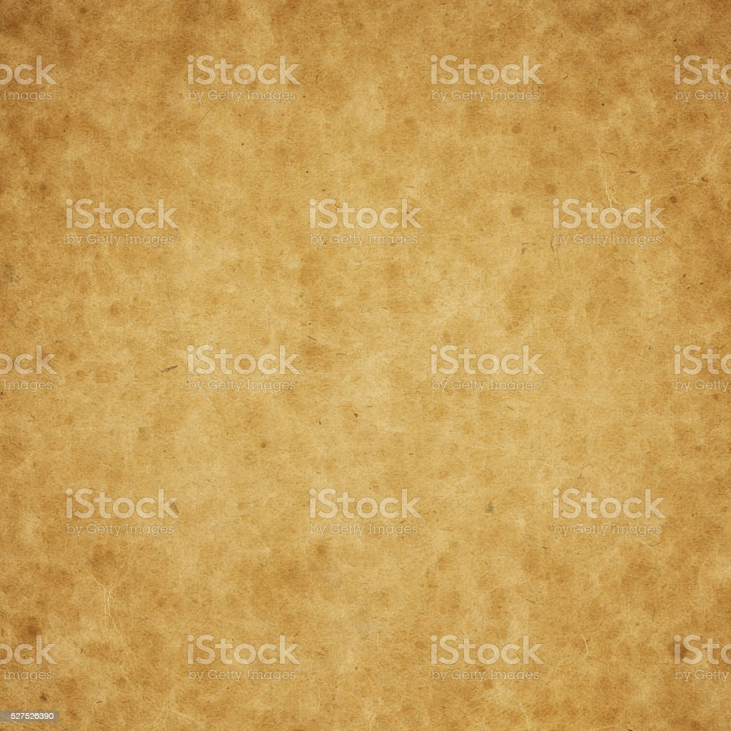 Textured paper with mottled wear pattern stock photo
