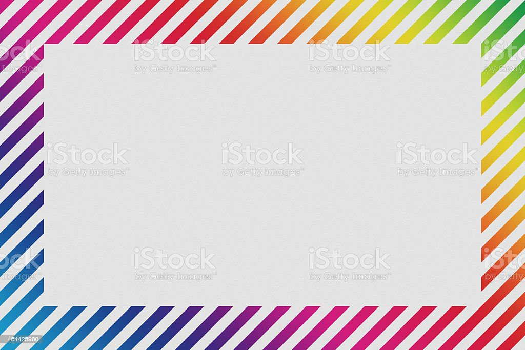textured paper with rainbow stripe border stock photo