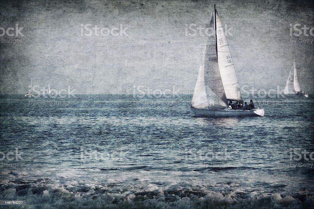 Textured sailboats at sea stock photo