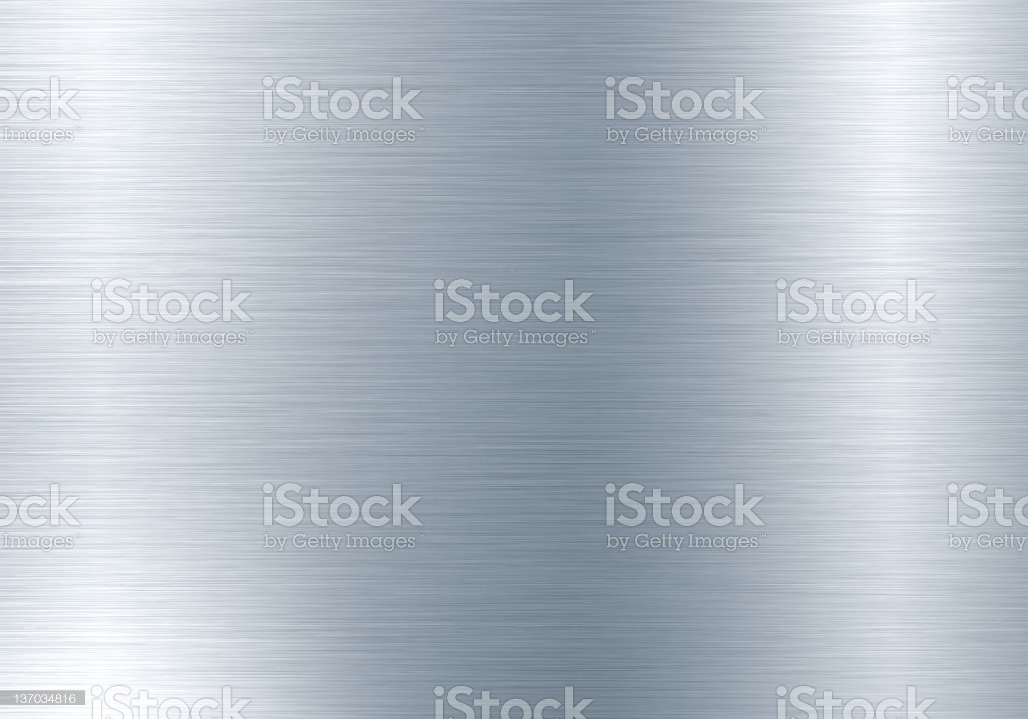 A textured, silver metal background royalty-free stock photo