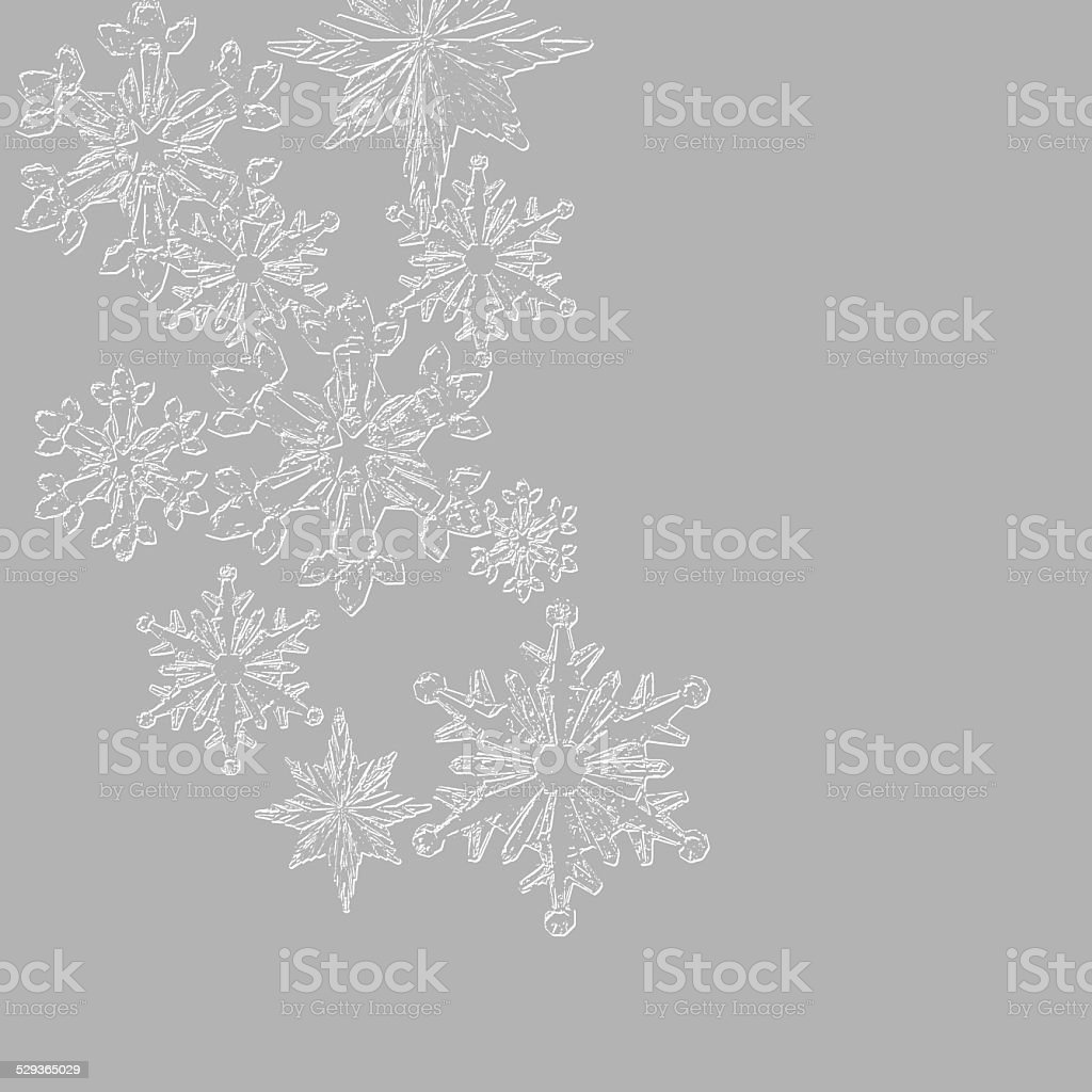 Textured snowflakes on gray colored background stock photo