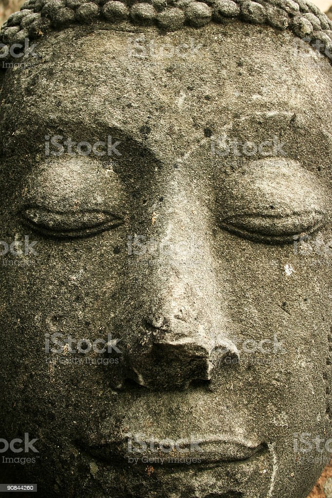 textured stone buddhas face thailand royalty-free stock photo
