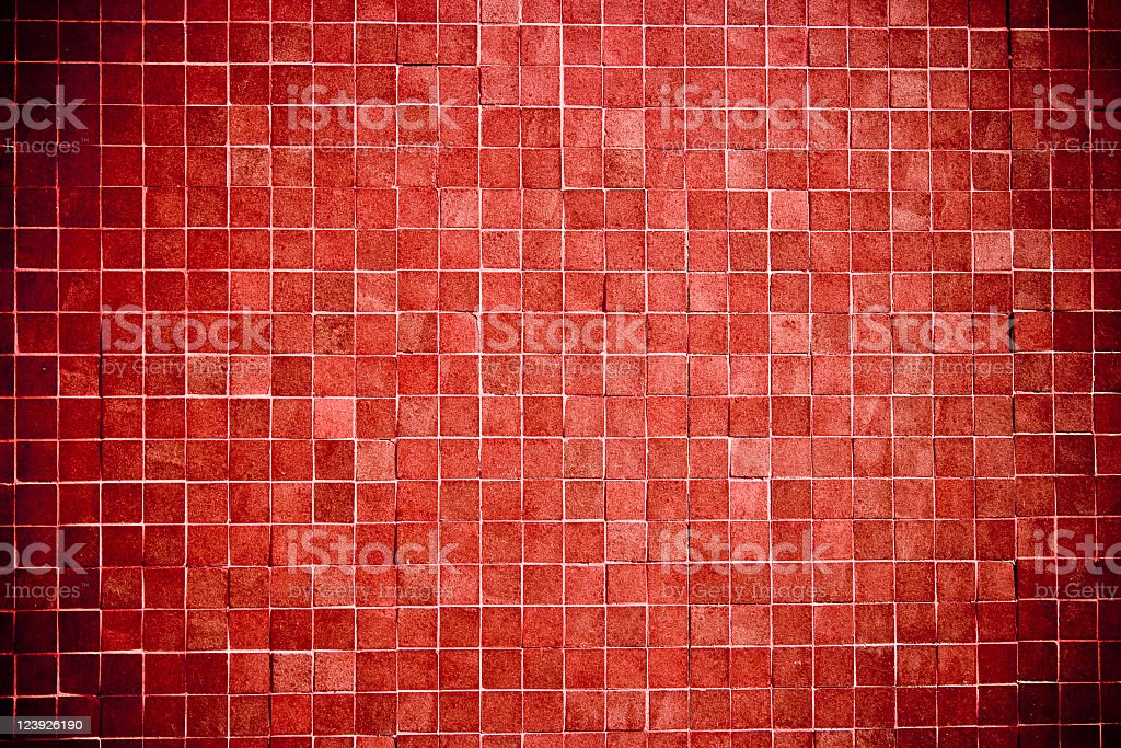 Textured vignette multishaded red tile wall background stock photo