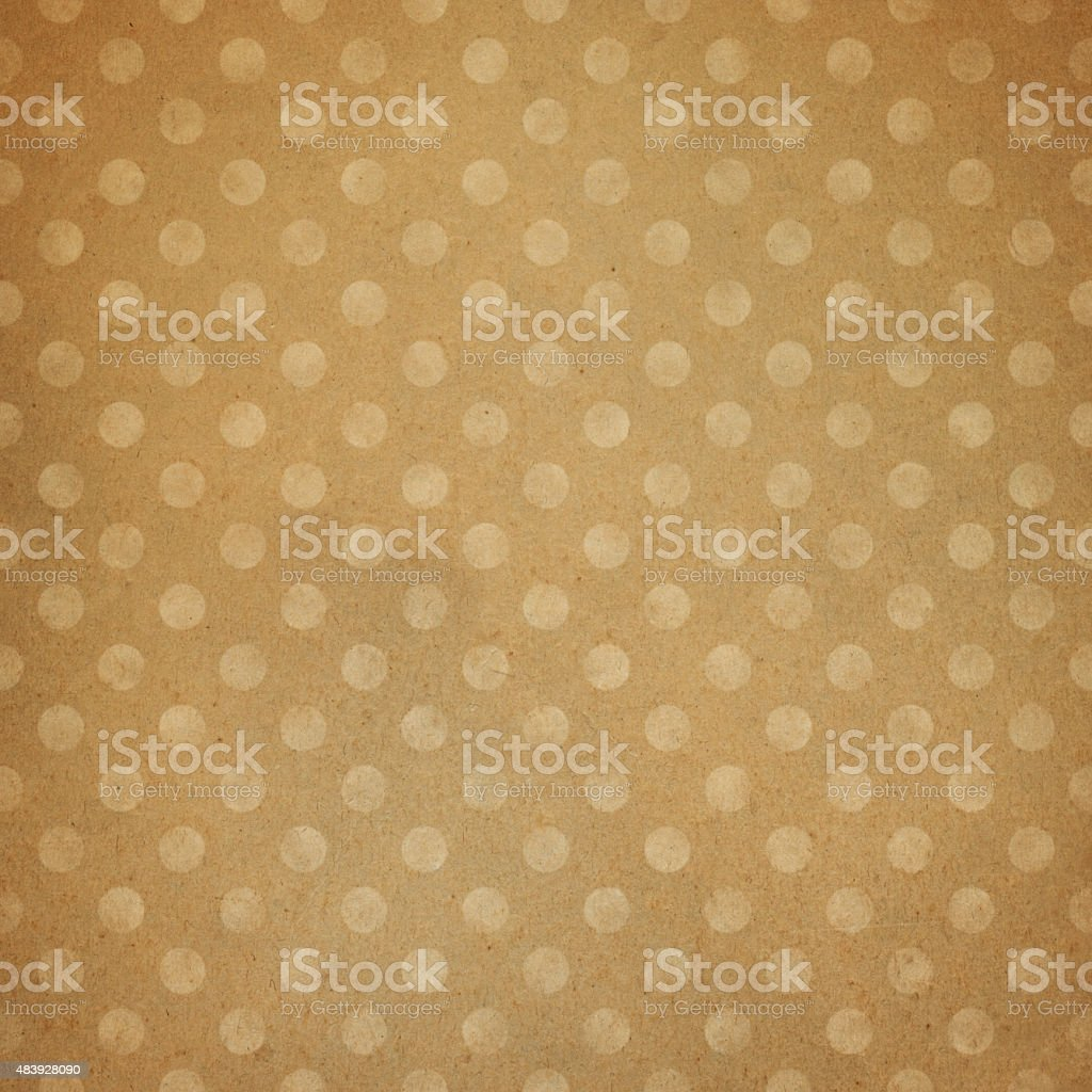 Textured worn paper with polka dot pattern vector art illustration