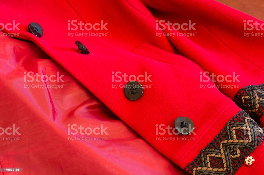 Texture-red coat with black buttons stock photo