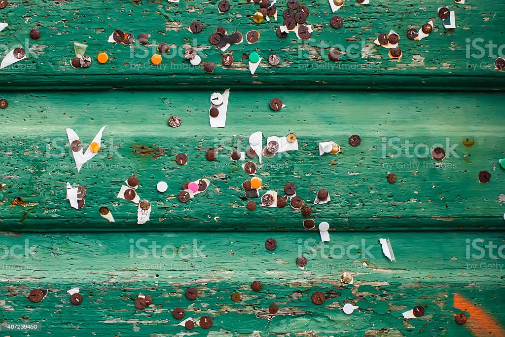 texturered green old wood planks with metal rusty pins stock photo