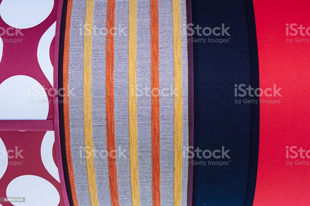 Textures of various printed and embroidered fabrics stock photo