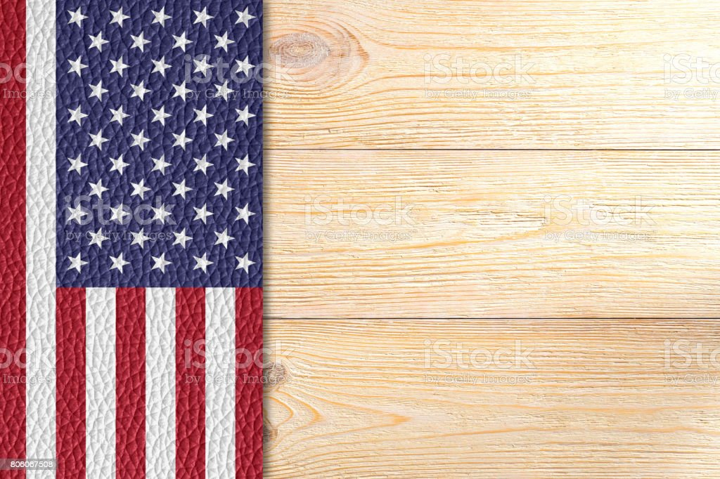texured united states flag over wooden planks stock photo
