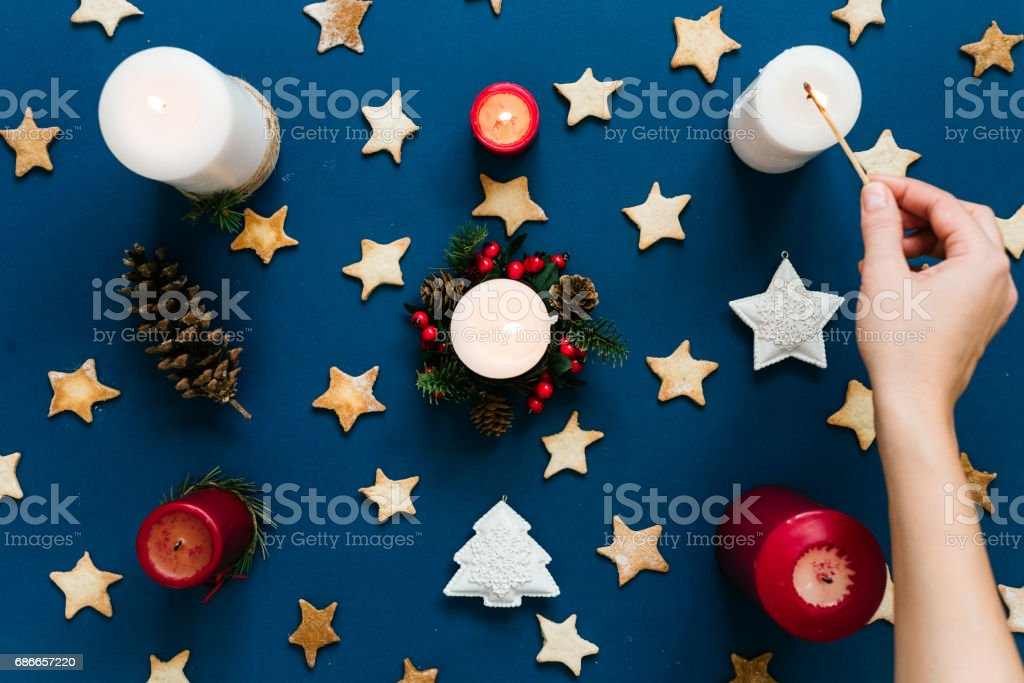 Tha hand lights up the candles, top view stock photo