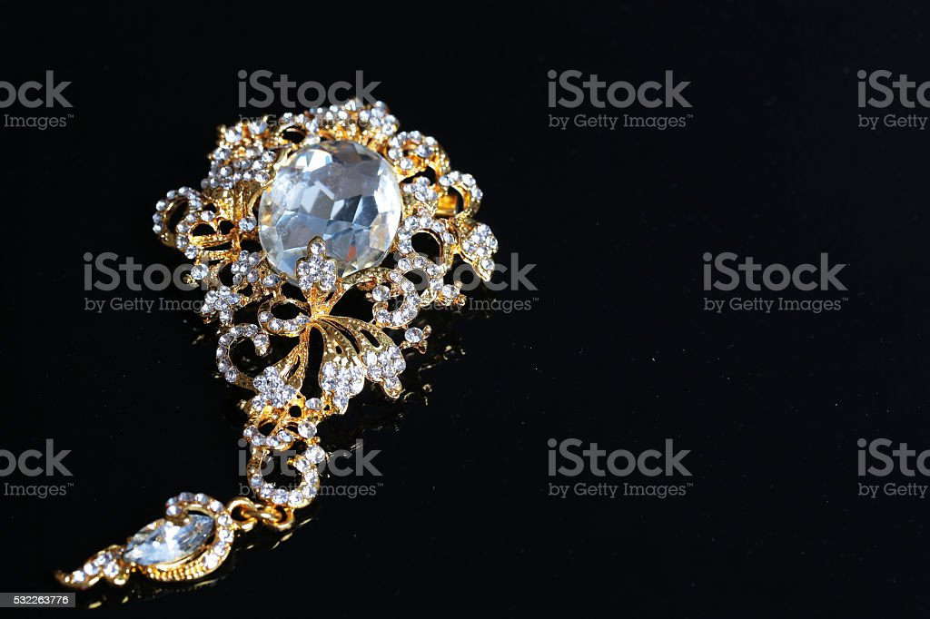 thai accessories wedding , gold brooch stock photo