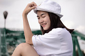 thai adult girl white T-shirt beautiful girl relax and smile