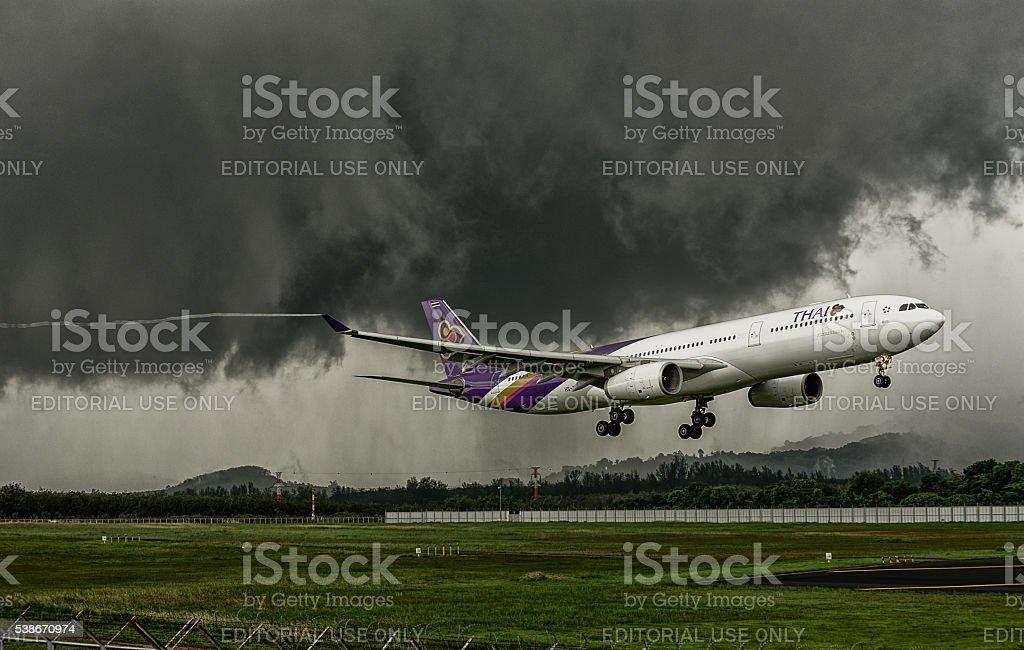 Thai airways airplane airbus 330-300, landing  at phuket airport stock photo