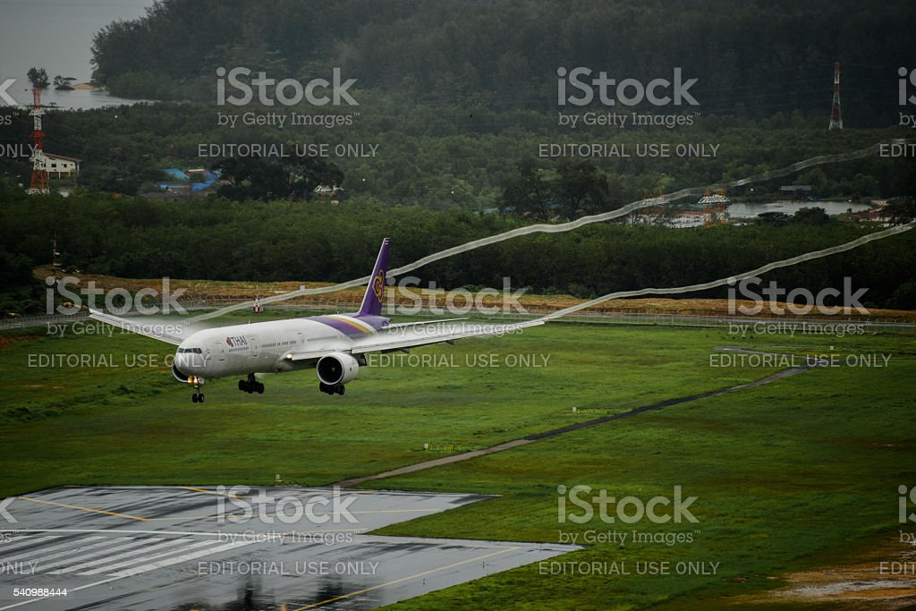 Thai  airways airplane , Boeing 777-300, landing  at phuket airp stock photo