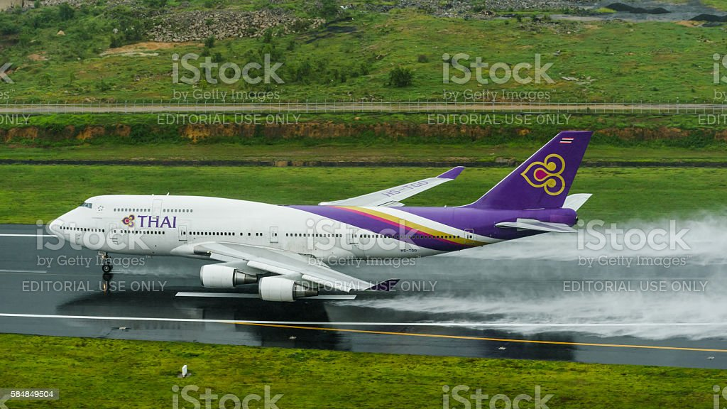 Thai  airways take off  at phuket airport on wet runway stock photo
