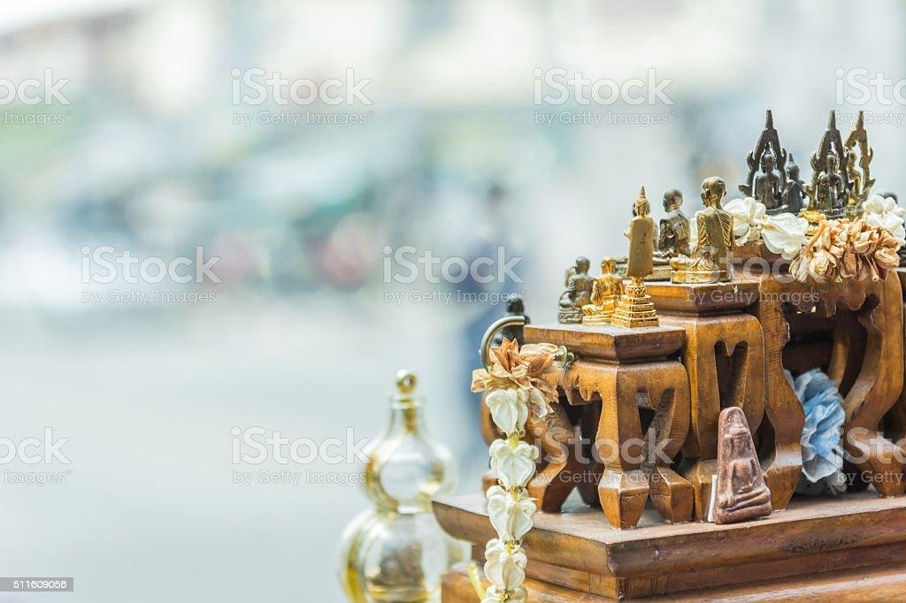 thai amulet buddha in car stock photo