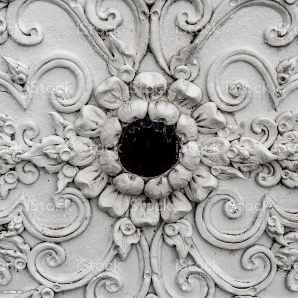 Thai ancient white stucco in temple stock photo