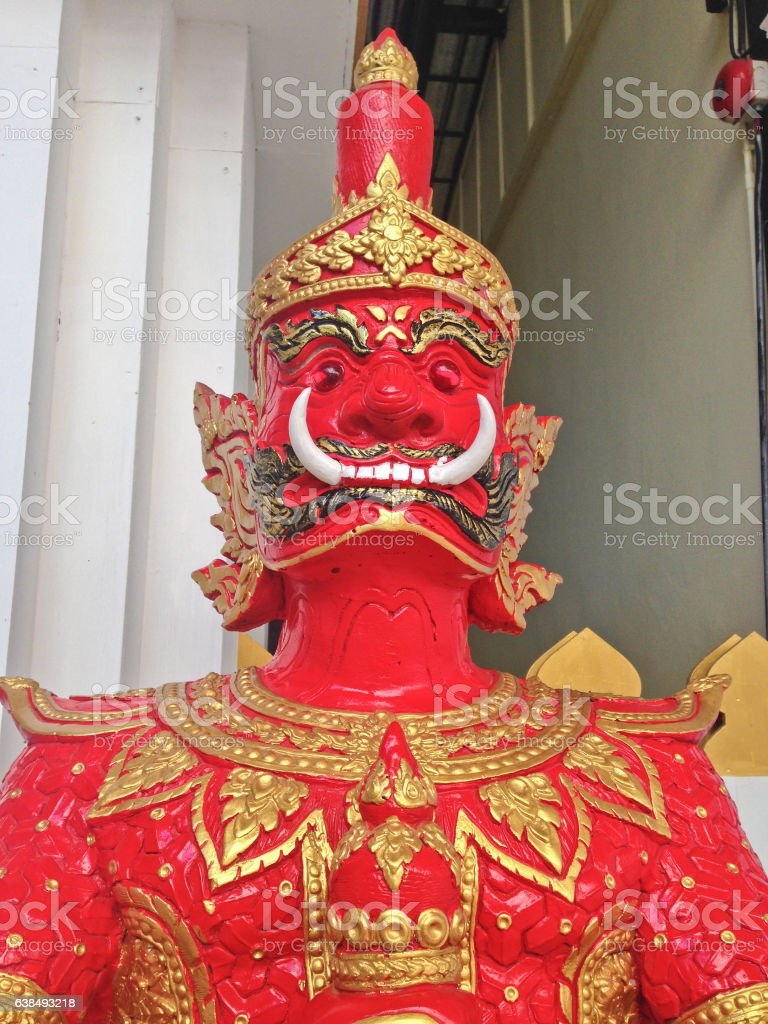 Thai Art : Part of Red Giant Statue stock photo