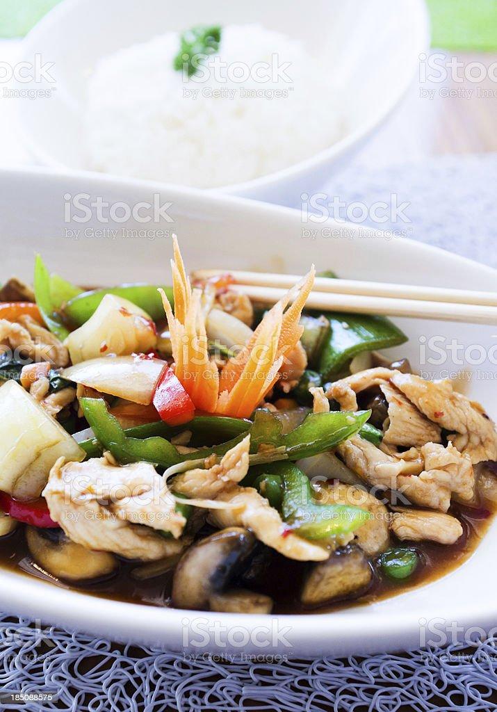 Thai basil chicken dish and bowl of jasmine rice royalty-free stock photo