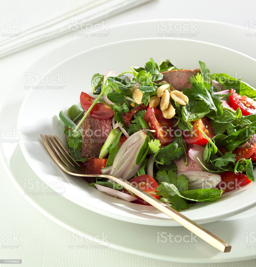 Thai beef salad in a white bowl royalty-free stock photo