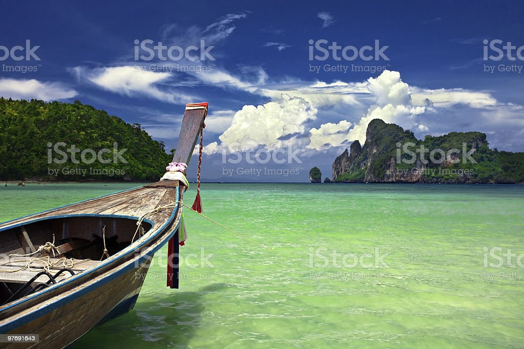 Thai boat ready to sail in the clear blue waters royalty-free stock photo