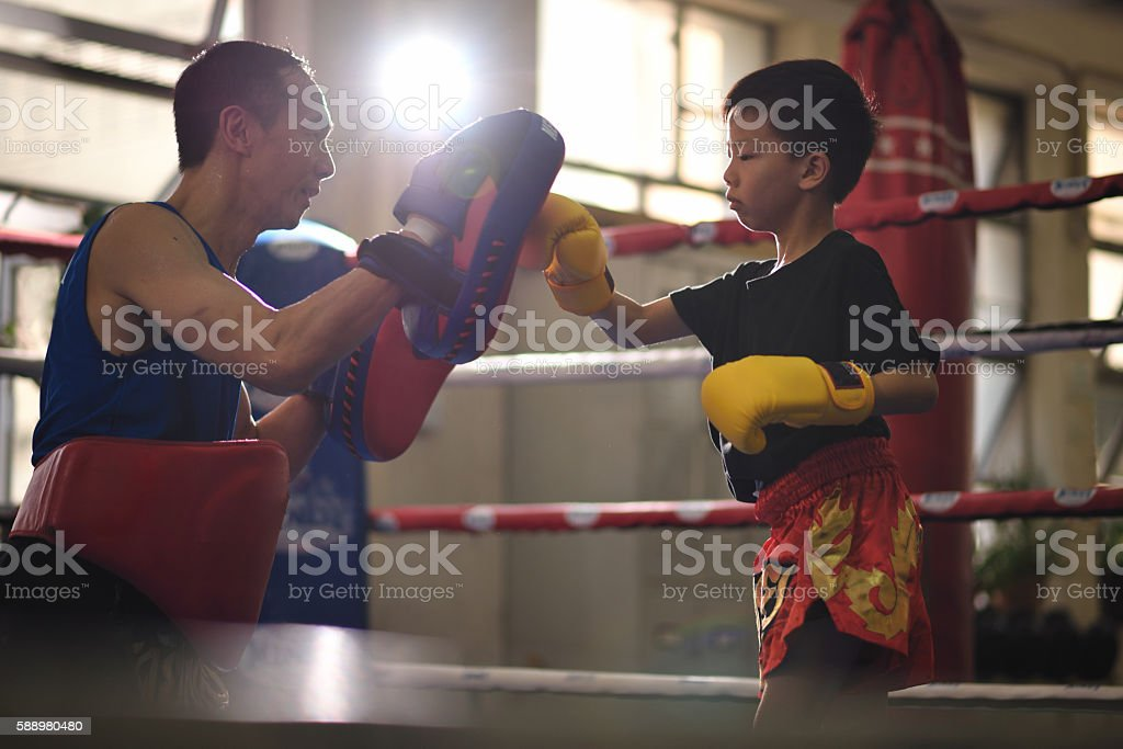 Thai boxing training for child stock photo