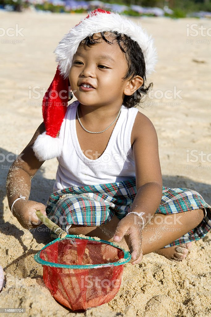 Thai boy playing on the beach royalty-free stock photo