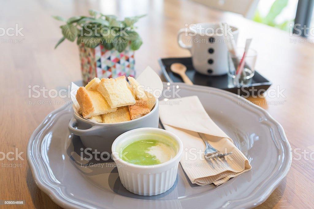 Thai bread with sweet green pandan dipping sauce stock photo