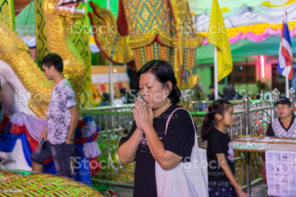 Thai buddhism people in buddhist pray for benefaction worship to Buddha in Thai temple stock photo