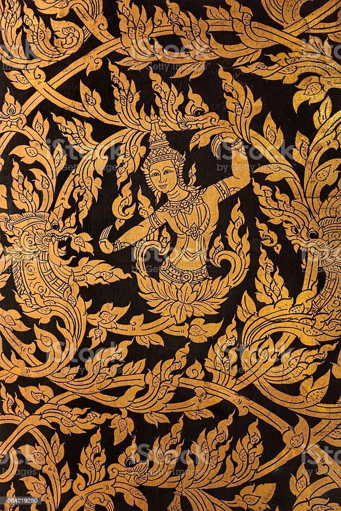 Thai Buddhist temple window shutter decoration. stock photo