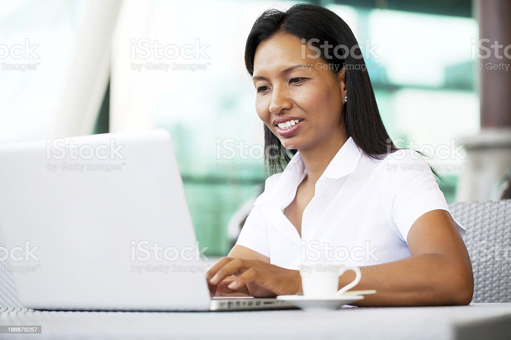 Thai business woman working on laptop. royalty-free stock photo