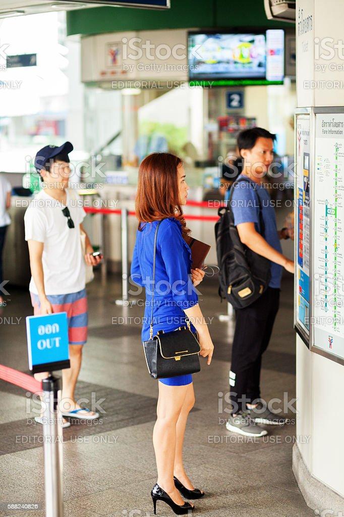 Thai businesswoman in blue dress stock photo