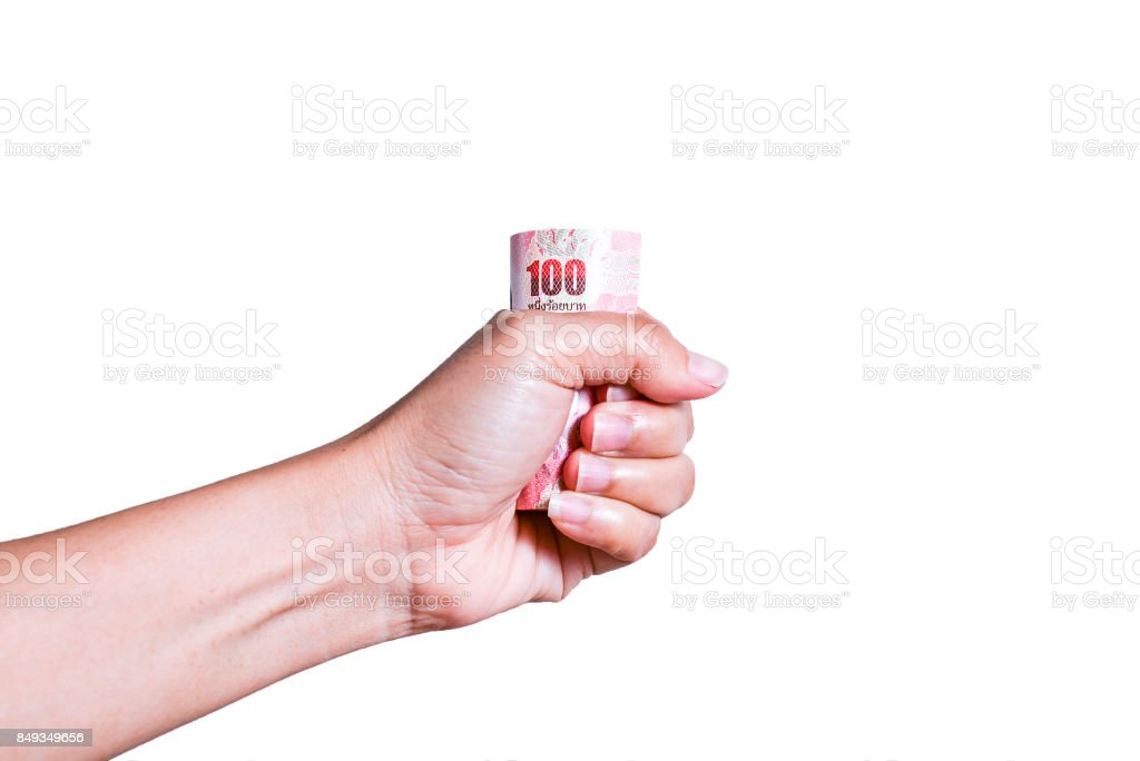Thai cash  in Asian women's hand on white background with clipping path stock photo