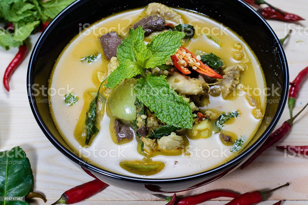 Thai chicken green curry on wooden background stock photo